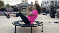sit and bounce on a mini trampoline